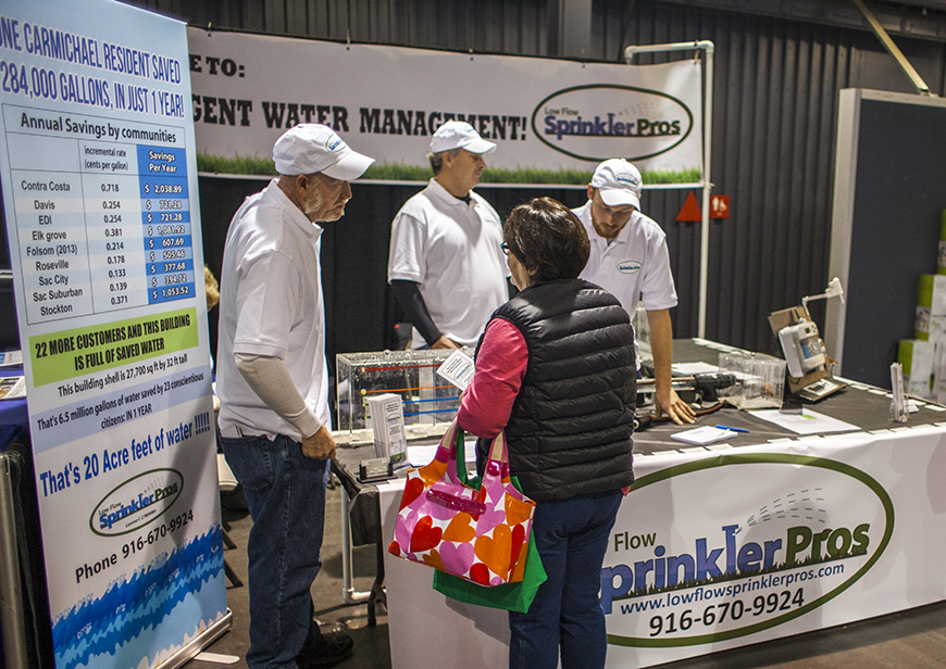 Our booth with the water savings sign
